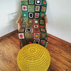 Old chair and old handmade blanket together with new puff