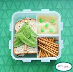 This little Christmas tree bento was for her afternoon nutrition break. She got half a chicken sandwich with a pea pod and pretzel tree. A cute little sprinkle star on the top. She also had a container of pretzel sticks and a container of unsweetened applesauce with tree sprinkles.