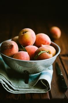 I would have the knife angled and one of the peaches cut in half