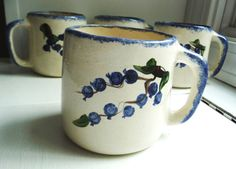 Set of 4 Artisan Made Blueberry Coffee Mugs with Hand Painted Fruit Design and Blue Sponge Trim. Handcrafted pottery.
