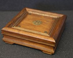 Elegant handmade wooden jewelry box. This the casket was made of smrk wood and covered shellac, gold paint and wax. Delicately decorated with brass elements. Perfect for that surprise engagement.