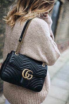 Beige chunky sweater, medium black leather Gucci Marmont Matelasse bag, balayage hair