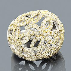 Designer Cocktail Rings: This Yellow Diamond Flower Ring in 14K gold weighs approximately 17 grams and showcases 4.35 carats of sparkling round diamonds. Featuring an intricate flower design and a highly polished gold finish, this ladies diamond cocktail ring is available in 14K white, yellow and rose gold.