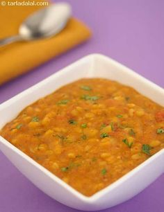 Masala Dal, comprising of four key varieties of pulses, cooked with onions and tomatoes, and perked up with a range of carefully chosen spices.Serve with hot rice and rotis. Veg Recipes, Curry Recipes, Lunch Recipes, Slow Cooker Recipes, Indian Food Recipes, Gourmet Recipes, Cooking Recipes, Healthy Recipes, Indian