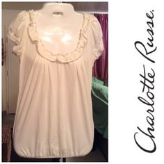 """Charlotte Russe Shirt Charlotte Russe Shirt is made of 60% Cotton and 40% Polyester. The Color is white. Comfortable and Stylish Top with a Tie String across the back. Size Medium. Laying flat from Arm to Arm """"16. The Length is """"25. This item is in Good condition, Authentic and from a Smoke And Pet free home. All Offers through the offer button ONLY. I Will not negotiate Price in the comment section. Thank You😃 Charlotte Russe Tops"""