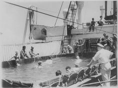 Jewish refugee passengers aboard the SS St. Louis bathe in the swimming pool on the deck of the ship.