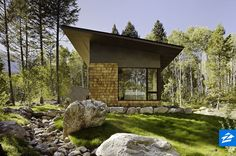 This cabin gets a modern makeover with lots of clean lines and floor-to-ceiling glass windows.