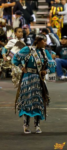 beautiful! I love the beadwork, the colors, the moves.