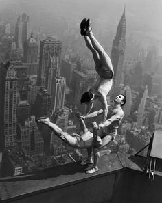 Acrobats Jarley Smith (top), Jewell Waddek (left), and Jimmy Kerrigan (right) perform a delicate balancing act on a ledge of the Empire State Building in Manhattan. August 21, 1934.