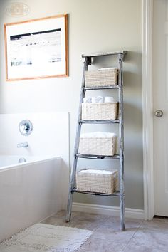 "Creative idea in using an old ladder as a decor piece in the bathroom. Gives it that ""Earthy"" feel."