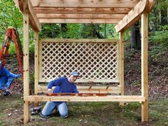 Build the flower box and the bench. Level each using a 4-foot level, and attach them to the posts using 4-inch decking screws (and carriage bolts for the bench). Once the pergola's construction is complete, apply two coats of semitransparent stain.   - PopularMechanics.com