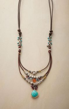 Add a touch of lively elegance to any look with our handcrafted leather, sterling bead and gemstone necklace.