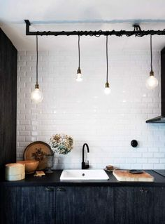 Subway tiles, industrial lighting...Charming