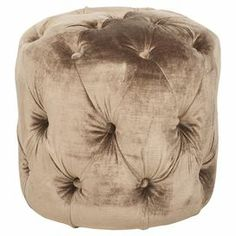 "Birch-framed ottoman with tufted mink brown upholstery.  Product: OttomanConstruction Material: Birch wood and fabricColor: Mink brownDimensions: 15.7"" H x 16.1"" Diameter Cleaning and Care: Dry clean recommended"