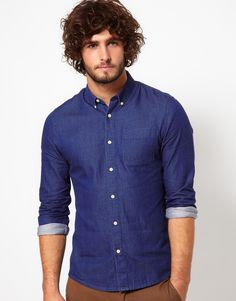 Denim shirts are cool. Just gon't go all 70s acid wash. Also, so are button down collars. Wear with chinos (and cuff that shit) http://rstyle.me/~F6ww