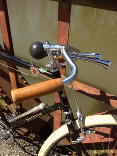 """Dropped North Road bars, quill stem, """"bobby-dodger"""" front brake lever, top bar-mounted shifter, and vintage  """"BritAlloy"""" frame pump lend just the right Path Racer vibe; cork grips and three-trumpet Condor horn complete the effect."""