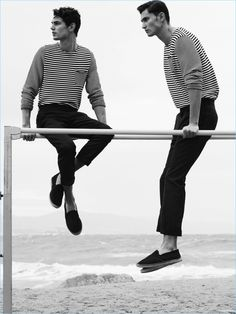 Sporting matching ensembles, Arthur Gosse and Dimytri Lebedyev wears striped pullovers from Massimo Dutti.