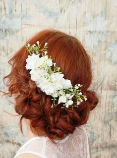 A beautiful way to wear flowers in your hair and a nice replacement for the traditional veil.