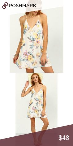 FLORAL BACKLESS DRESS FLORAL PRINT STRAPPY SWING CAMI DRESS. MATERIAL DOES NOT STRETCH.   -SIZING/MATERIAL CONTENT AVAILABLE IN LAST IMAGE -BUNDLE DISCOUNTS AVAILABLE ON 3+ITEMS Dresses Mini