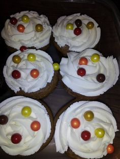Fall 2015 Spice cake cupcakes with apple filling. Cream cheese buttercream icing (Homemade) with candy balls.