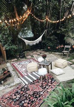Moroccan party decor bohemian backyard party hammock outdoor rugs poufs