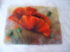 My newest passion is wool drawing (felting wool) – creation of the most wonderful art works by layering different color wool without use of water.