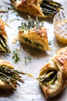 Asparagus and Brie Puff Pastry with Thyme Honey | halfbakedharvest.com #brunch #spring #recipe Brie Puff Pastry, Savory Pastry, Frozen Puff Pastry, Savory Tart, Puff Pastry Recipes, Puff Pastries, Pastries Recipes, Asparagus Rolls, Asparagus Appetizer