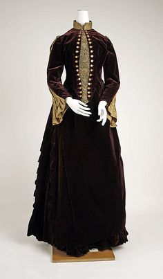 1887-1889 silk and metallic dress.  Like the buttons and sleeve insets.  Via MMA.