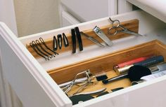 Install a magnetic strip in a drawer to hold all your bobby pins, tweezers, and any other metal tools