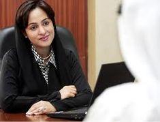 Acacia trees growing in desert suburbs near Fujairah   United Arab     United Arab Emirates woman