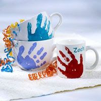 Love these hand print mugs