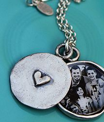 "They attach photo!  A two piece locket is handmade from scratch iand then handcasted in beautiful fine pewter. The top piece is handstamped on the inside with names, a date or a secret message and swings back and forth over the bottom locket piece, allowing little ""peeks"" of your photo."