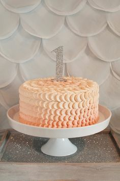 Beautiful ombre peach petal cake for 1st bithday made by @Made From Scratch. Handmade silver glitter 1.