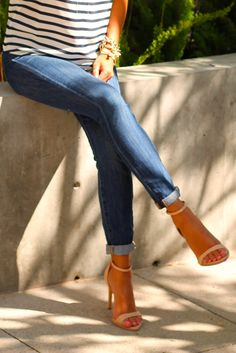Skinny jeans, classic striped top, glam accessories, and sexy heels
