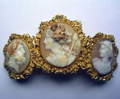 Horned Helmet shell cameo tiara in a Repousse gold mount, circa 1840. The finely carved shells depict Bacchus, Zeus, and Mercury.