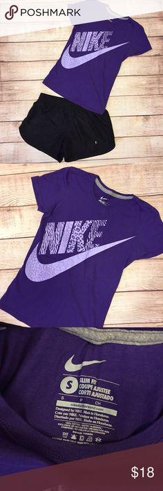 Nike purple shirt Purple. Animal print pattern in letter. Women's fitted T. Great to pair with yoga pants for a sporty look. Worn only a couple times. No flaws. Nike Tops Tees - Short Sleeve