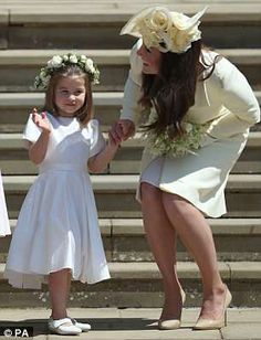 All of the bridesmaids, in their bright white dresses, looked like miniature versions of M...