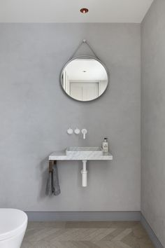The Patterned House by MWAI #bathroom #bathroomdesign #interiorinspiration #interiors #interiordesign #grey #bathroommirror #whitemarble #marblesink
