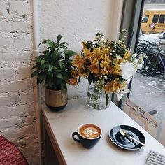 Afternoon pit stop...✨☕️ #coffeeshopcorners #onthetable  .  .  .  .  .  .  .  .  .  #coffeeshopvibes #cafelife #cafehopping #chasinglight #pursuepretty #flatlay #flatlays #livelittlethings #theartofslowliving #nyclife #newyorkstateofmind #coffeebreak #verilymoment #myview #coffeeeee #latteart #folklife #newyork_instagram #newyork_ig #theprettycities #prettycitynewyork #flowerstagram #flowers #latergram #afternoontea #momentsofmine #momentslikethese