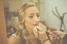 Bride with 1930s glamour inspired red lipstick and bridal makeup, from 'Suzanne Neville And Red Roses For a Vintage Glamour Inspired Country Manor Affair'  http://www.modernvintageweddings.com/
