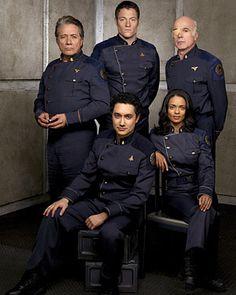 "Battlestar Galactica - Season 4 - Edward James Olmos as Admiral William Adama, Tahmoh Penikett as Karl ""Helo"" Agathon, Alessandro Juliani as Lt. Felix Gaeta, Kandyse McClure as Dualla and Michael Hogan as Col. Saul Tigh"