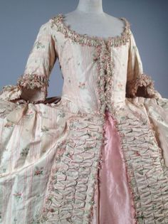 Detail, robe à la francaise, c. 1760. Spink striped silk brocaded with flower sprays on cream ground; petticoat: pink silk taffeta.