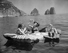 "swearronchanel: "" hauntedbystorytelling: "" Three young women eat spaghetti on inflatable mattresses at Lake of Capri, 1939 (AP Photo / Hamilton Wright) "" the life I want to live "" Vintage Italy, Italia Vintage, Weird Vintage, Vintage Love, Vintage Photographs, Vintage Photos, Cristina Ferreira, Photography Beach, Photography Magazine"