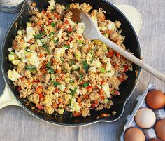 Southwest Scramble  8 eggs  2 mild chicken sausages (or pork or sausage of choice)  1/2 teaspoon oregano  1/2 teaspoon paprika  1 zucchini, diced  1/2 red bell pepper, finely diced  1/2 orange bell pepper, finely diced  1 plum tomato, chopped  1/4 cup fresh cilantro, chopped  salt and pepper to taste