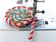 Sew twine into a spiral to make a mat
