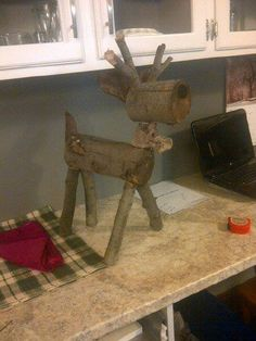 Log Reindeer. Made this little buddy for my front porch Christmas decorations. :) Can't get over how cute he is.