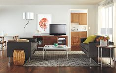 I like how the TV is right justified, and how they worked a round dining table into the space