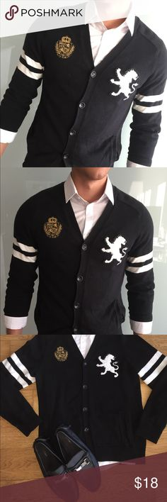 Express Lion Logo Button Up Cardigan This lion logo cardigan by express is in great condition. It's black with white lion logo and strips across the arms.   Size: Med  Color: Black & white  Condition: Great condition  * Shoes, shirt, and belt not included * Express Sweaters Cardigan