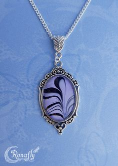 Fantasy necklace with a black – pastel purple marbled pendant. Made by Rowan Hogervorst - Ronafly