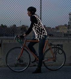 After years of wearing a bright yellow vest while biking, cyclist Audrey Robinson decided to invent her own reflective safety garment. Bike Rollers, E Textiles, Fashion Themes, My Ride, Lightning, Vest, One Piece, How To Wear, Clothes